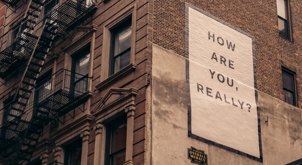 Quote painted on the side of a building reading: